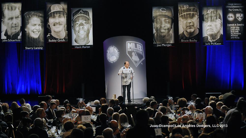 Actor Jason Alexander, in George Costanza-esque Yankees jersey, opens up the program.