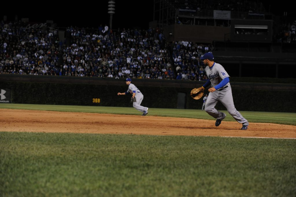 Blake DeWitt and James Loney in action at Game 1 of the 2008 National League Championship Series in Chicago. (Jon SooHoo/Los Angeles Dodgers 2008)