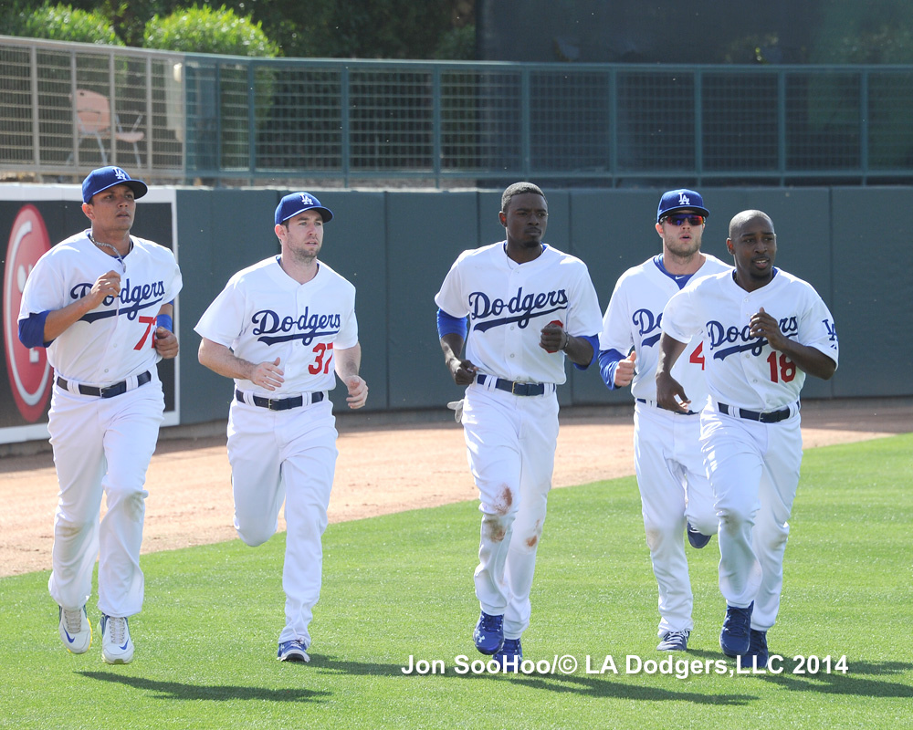 Mike Baxter, second from left, runs with fellow reserve candidates Miguel Rojas, Dee Gordon, Nick Buss and Chone Figgins.