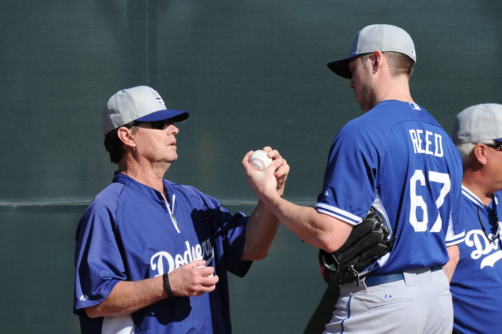 Pitching coach Rick Honeycutt with Chris Reed at Spring Training (Jon SooHoo/Los Angeles Dodgers)