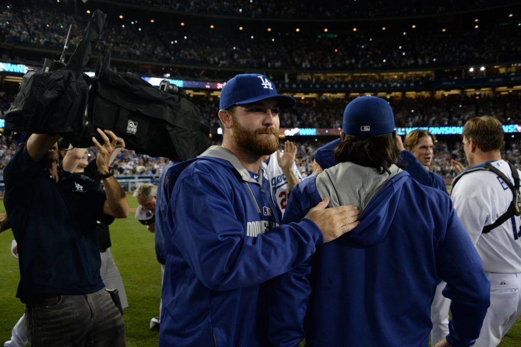 Chris Withrow joined in the Dodgers' NL West title celebration September 24 (Jon SooHoo/Los Angeles Dodgers)