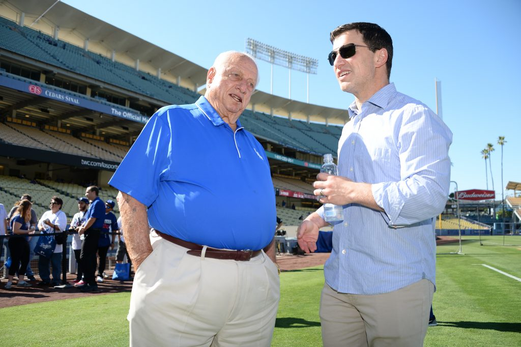 Tommy Lasorda, one of the people not interviewing for the Dodger managerial opening, with Andrew Friedman. (Jon SooHoo/Los Angeles Dodgers)