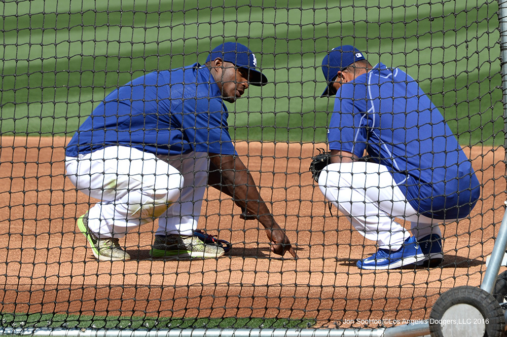 Yasiel Puig and Dave Roberts prior to Saturday's game