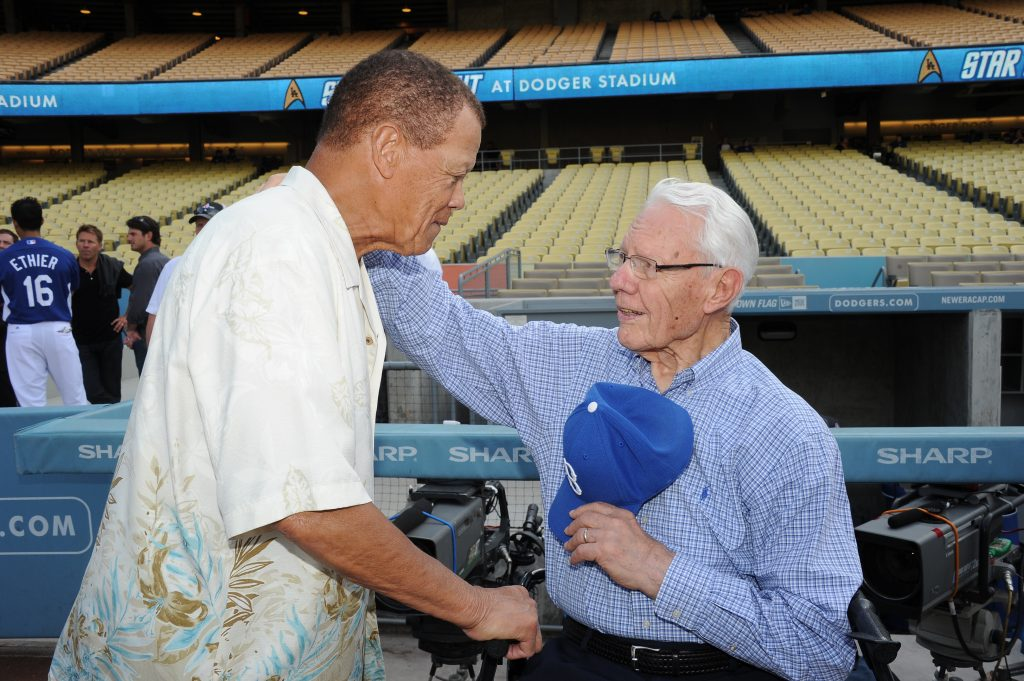 Maury Wills greets Lee Pfund in August 2012 (Jon SooHoo/Los Angeles Dodgers)