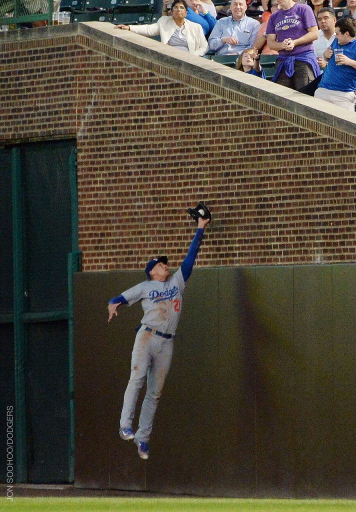 Trayce Thompson leaped near the bricks along the right-field foul line for this catch in the bottom of the fourth.